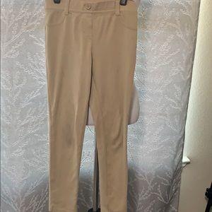 Girls uniform pants in beige.